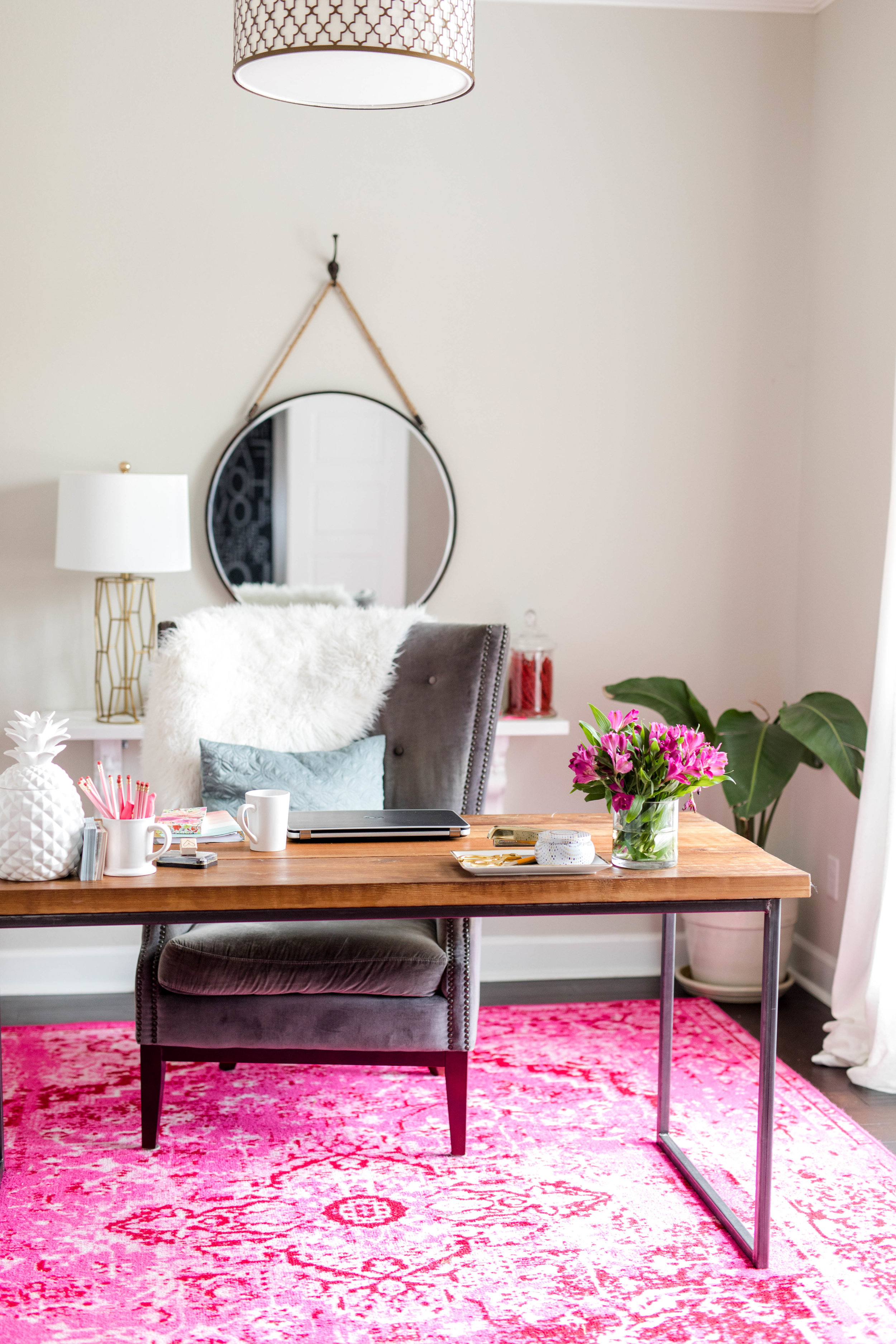I had a custom desk made for my space. I wanted wood with a little metal detail to keep it modern and light. The chandelier is from  Wayfair , one of my favorite go to places for easy online shopping and great prices.