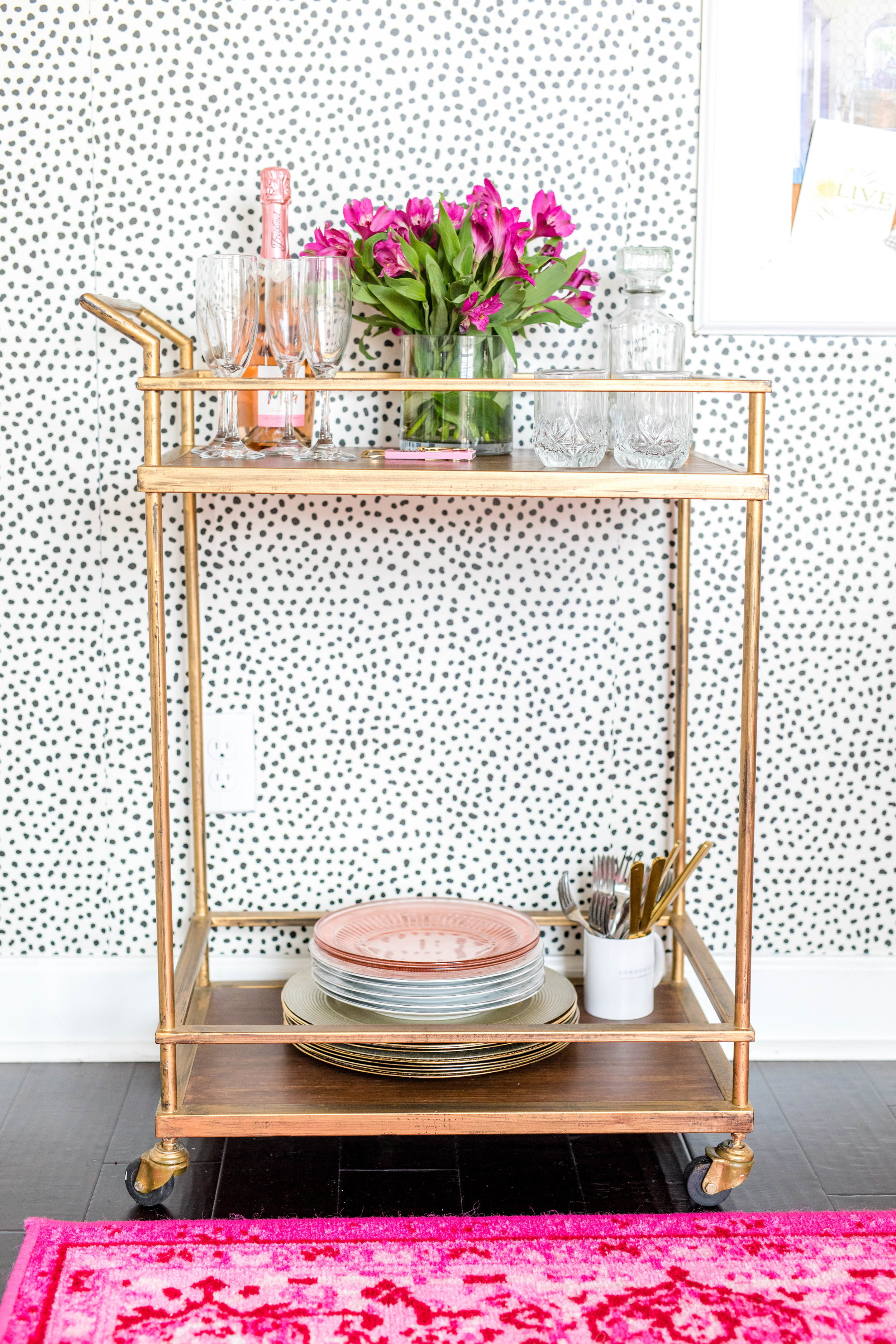The wall paper is from  Jillian Harris  partnership with MK Wallpaper, and the rug is from  RUG USA.