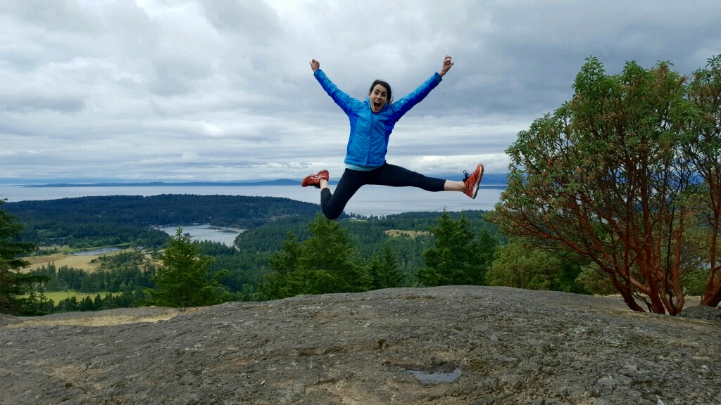 Jumping for joy on the top of Mt. Young, San Juan Island, WA.