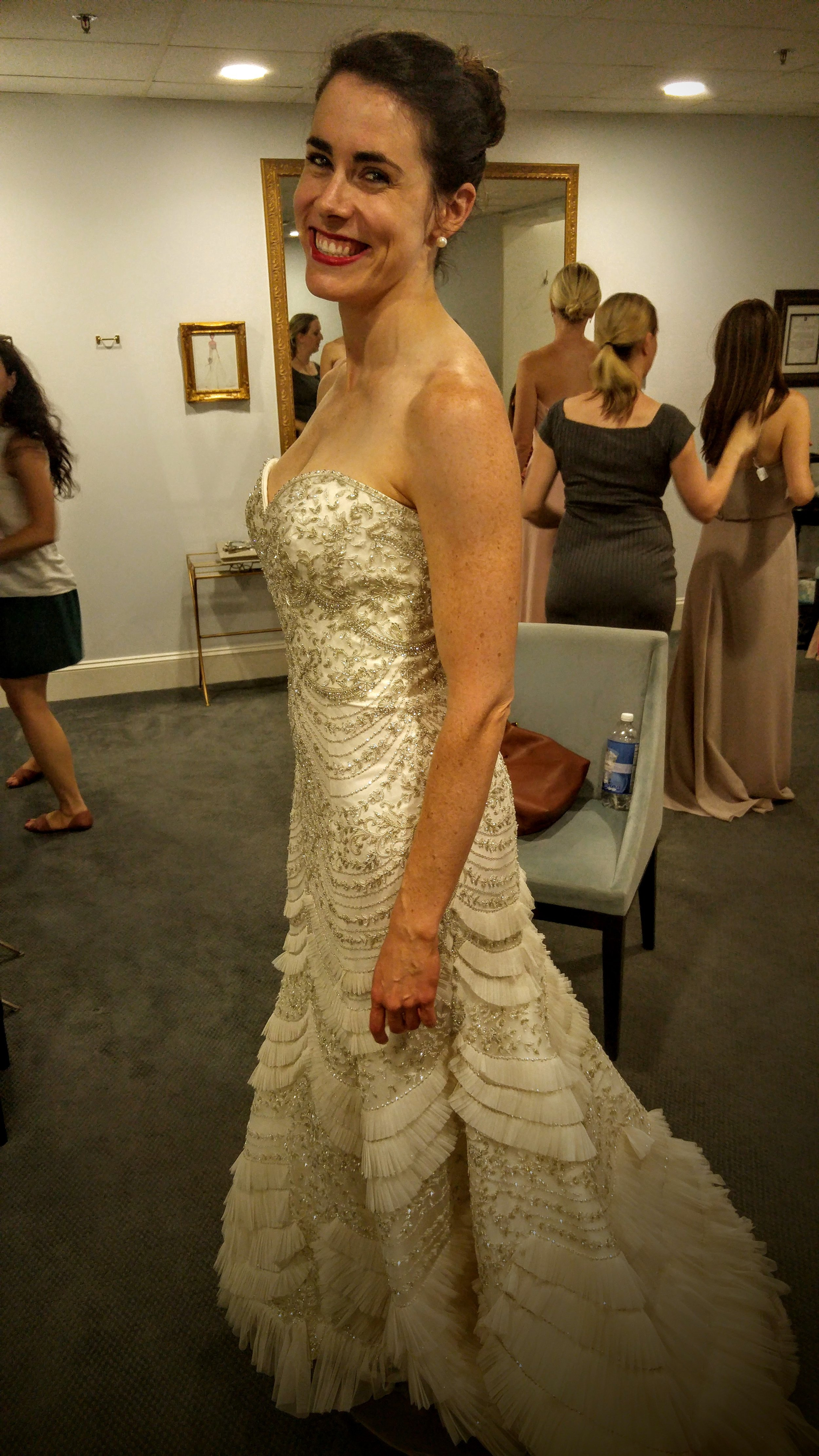 First problem: it's strapless, and would look weird with straps sown onto it. Second problem: it looks like an evening gown, not a wedding gown. Third problem: it was $5,000.