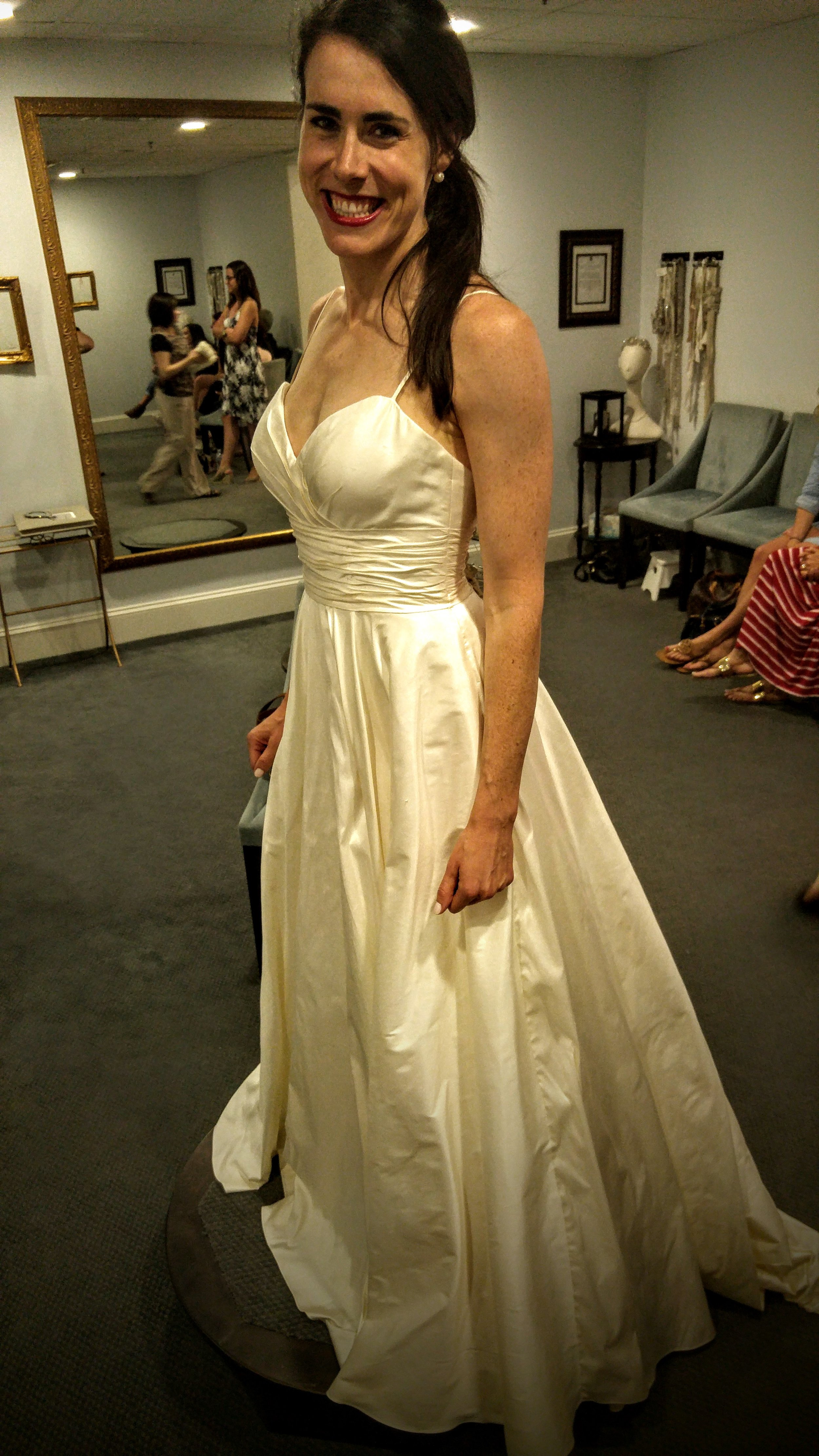 Nowwwww we're getting somewhere (note: the lighting makes this dress look yellowish, but it was really ivory).This was the first dress I tried on that fit me *perfectly*. The only problem is that it was too low-cut and I didn't like the spaghetti straps. But then we added a jacket: