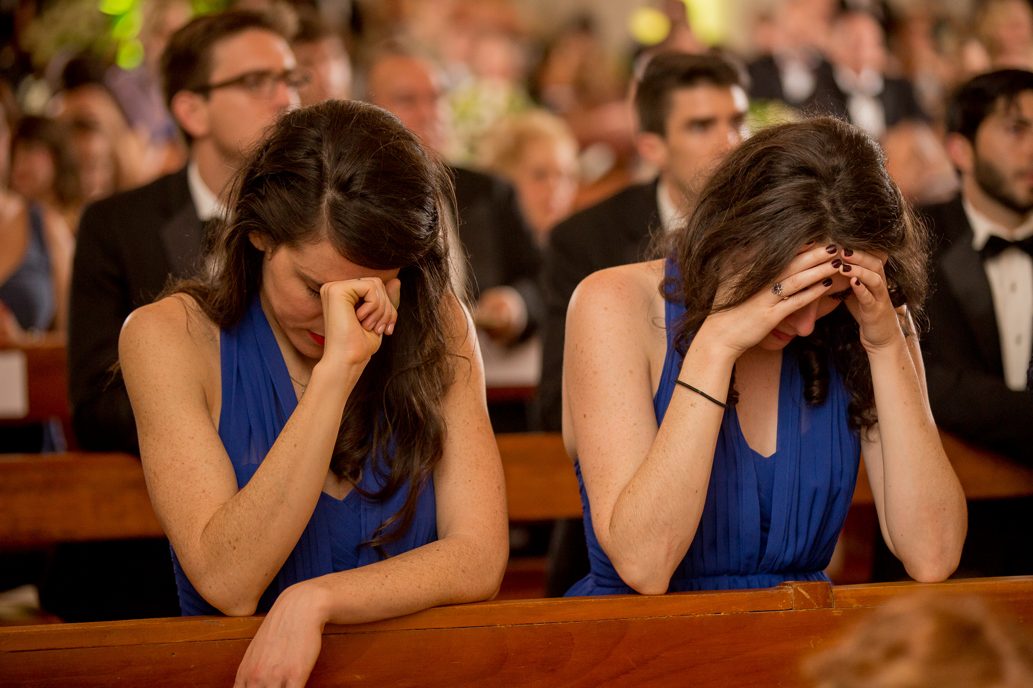 My sister and me, praying during our brother's wedding in 2015. This was a particularly difficult moment in my waiting season as a single woman, which I think comes through in my posture and facial expression.  Photo by  Yorch Sans Fotografia.
