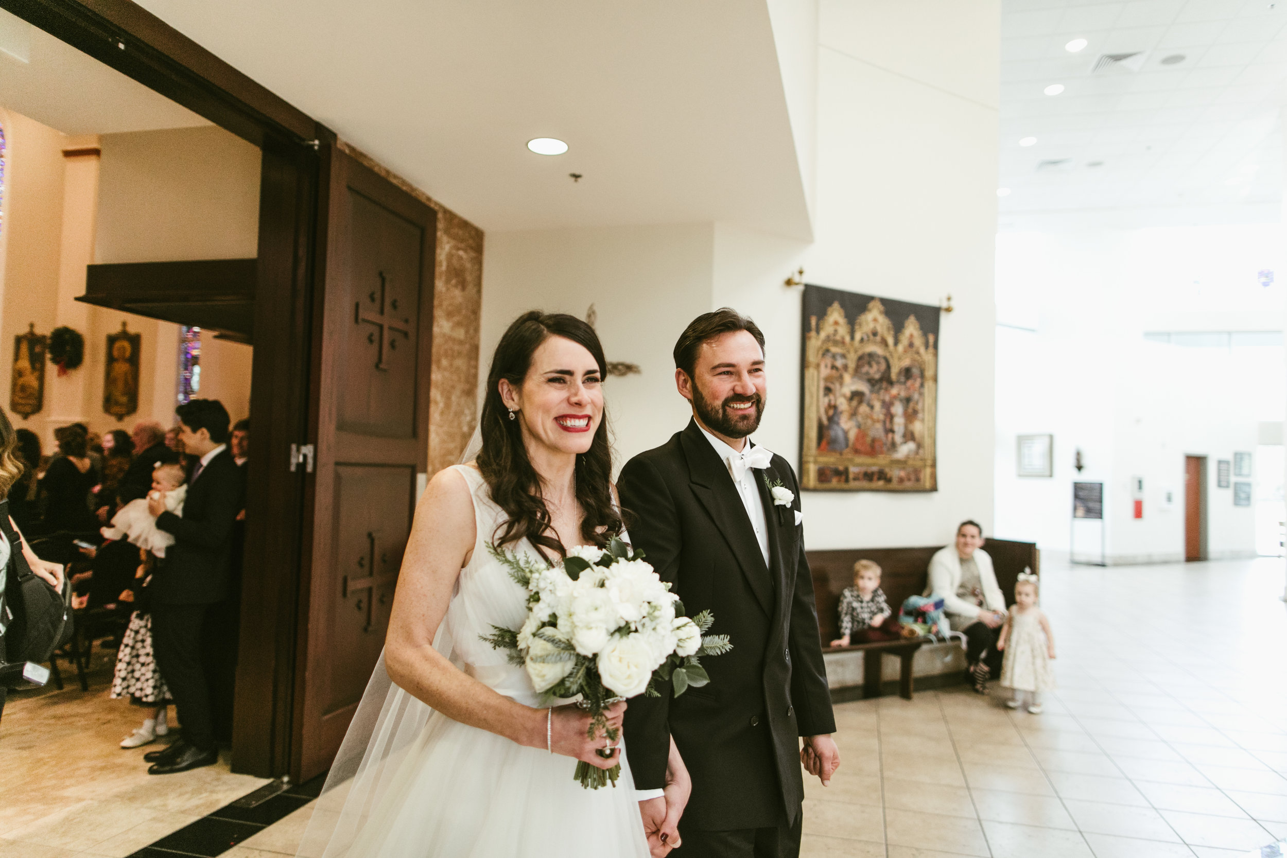 All smiles on the happiest day of our lives (so far): 12/29/16. Photo by  Leah Muse.