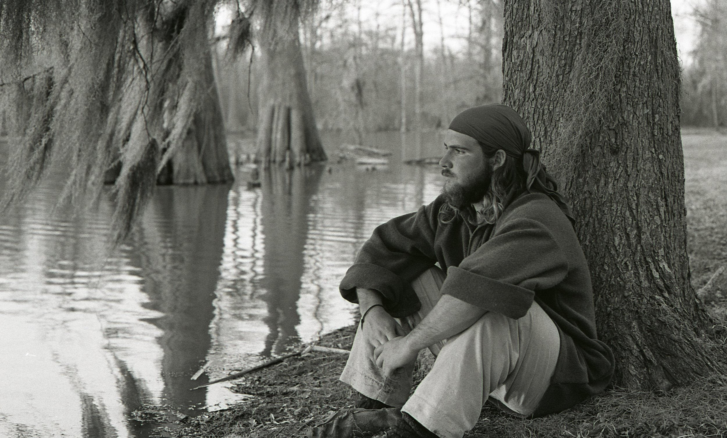 John DiFulvio leans against a tree deep in the Mississippi Delta in April 1977. As the end of La Salle: Expedition II winds down, he considers the journey's end and the many journeys of life that lie ahead. (Photo by Marc Lieberman)