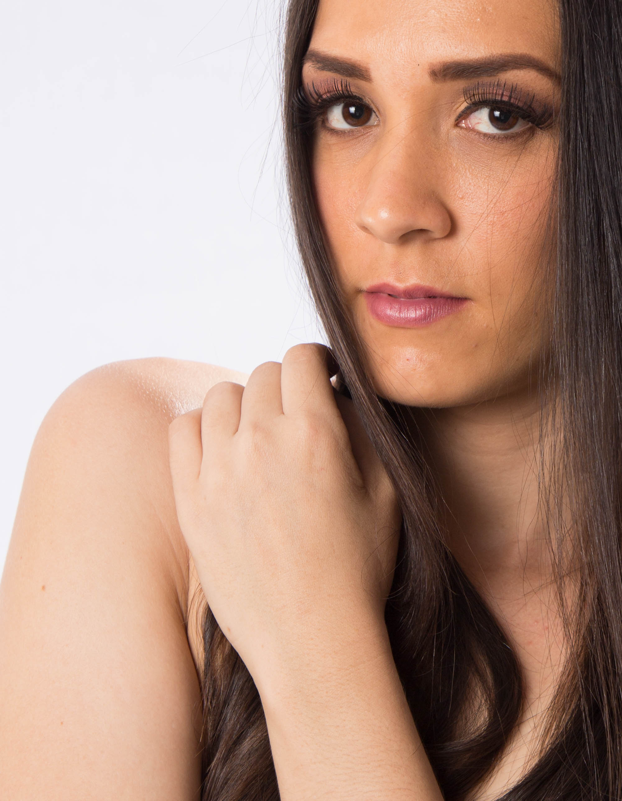 The model's natural skin tone does not match the tone of the base she used.