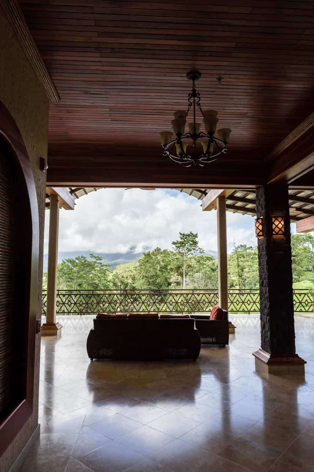 Under the covered area of the Aracari Terrace facing the terrace area for a wedding ceremony.