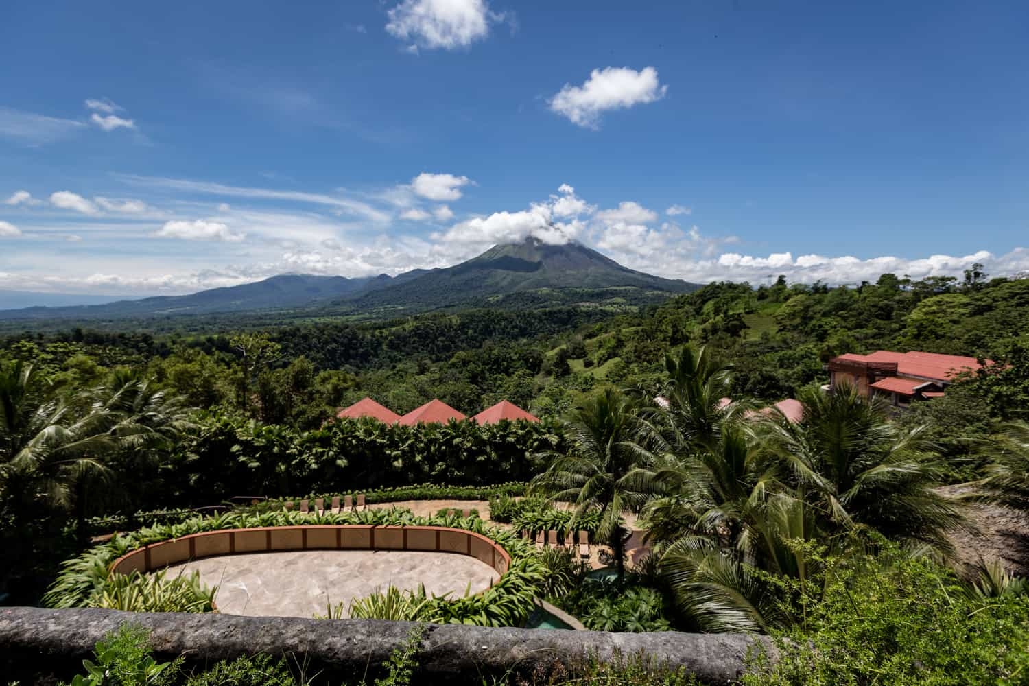 View of the Sunset Terrace from above with the Arenal Volcano in the distance.