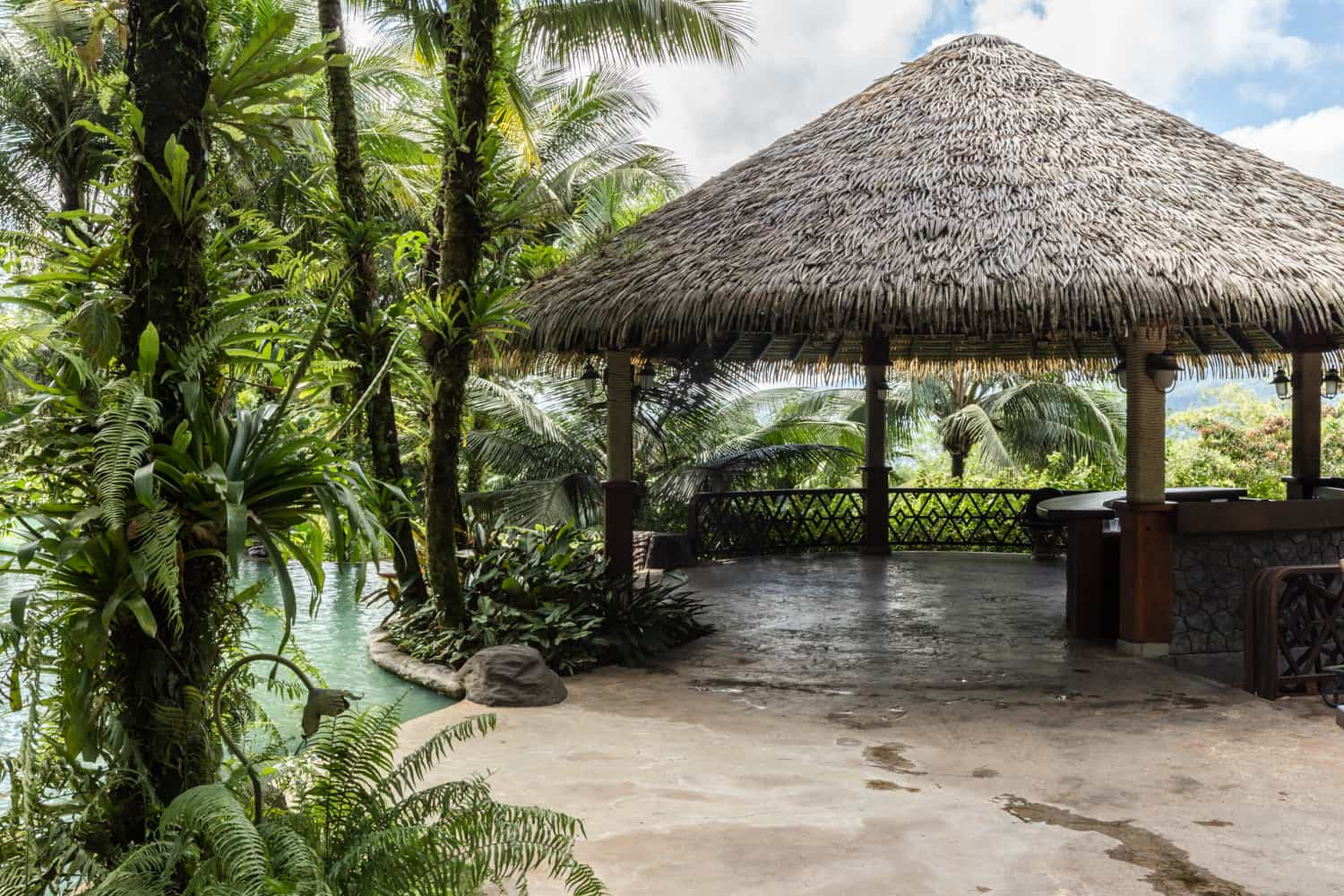 The hut at Ranchito for covered wedding ceremonies and view of Arenal Volcano.