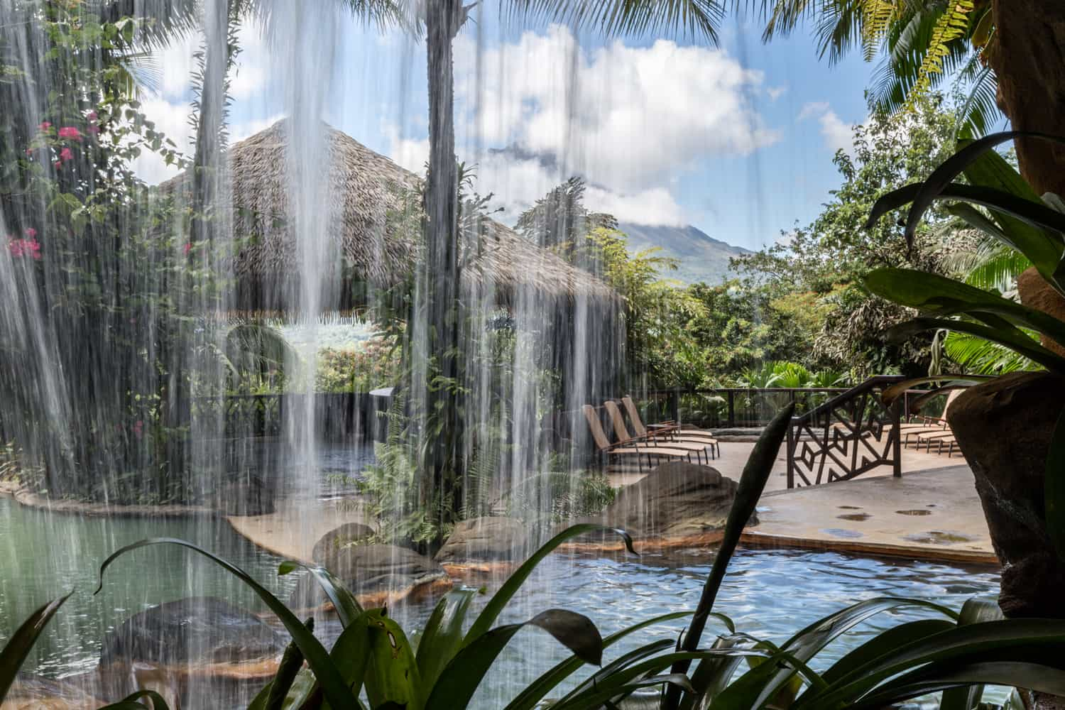 View of the Ranchito Terrace wedding ceremony and reception location from behind a waterfall.