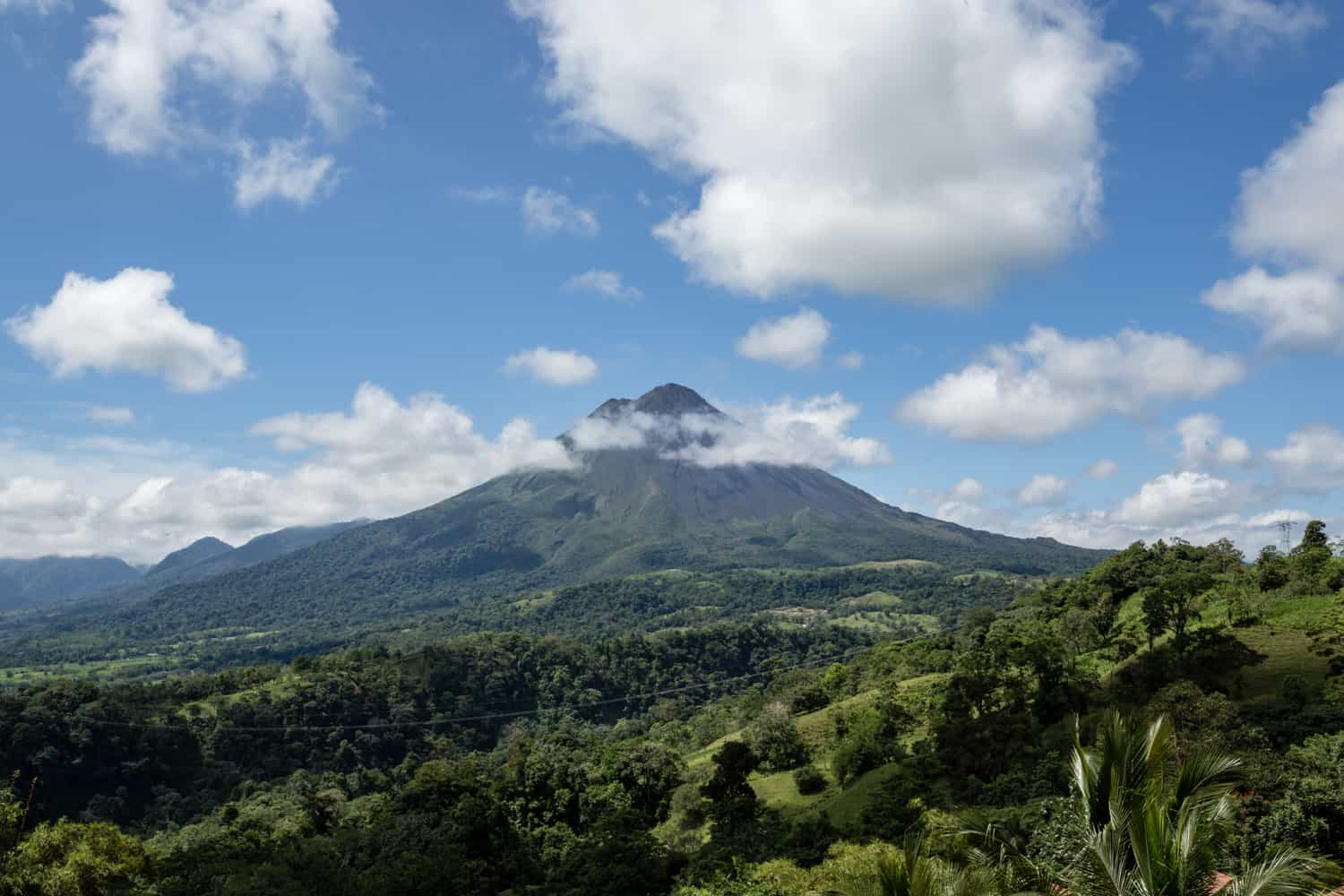 View of the Arenal Volcano from Ranchito Terrace wedding site at The Springs Resort & Spa.