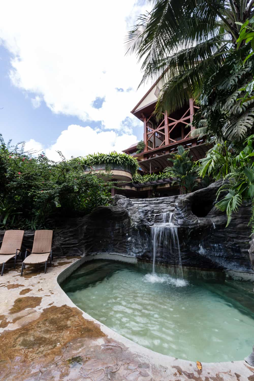 Thermal pool and waterfalls by wedding ceremony location at The Springs Resort & Spa.
