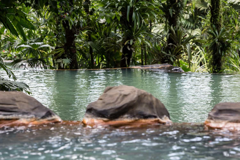 Backside of waterfall at thermal pool at The Springs Resort.