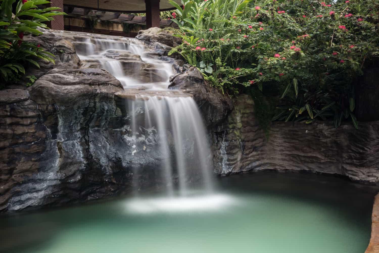 Waterfall near The Springs Resort's submerged bar.