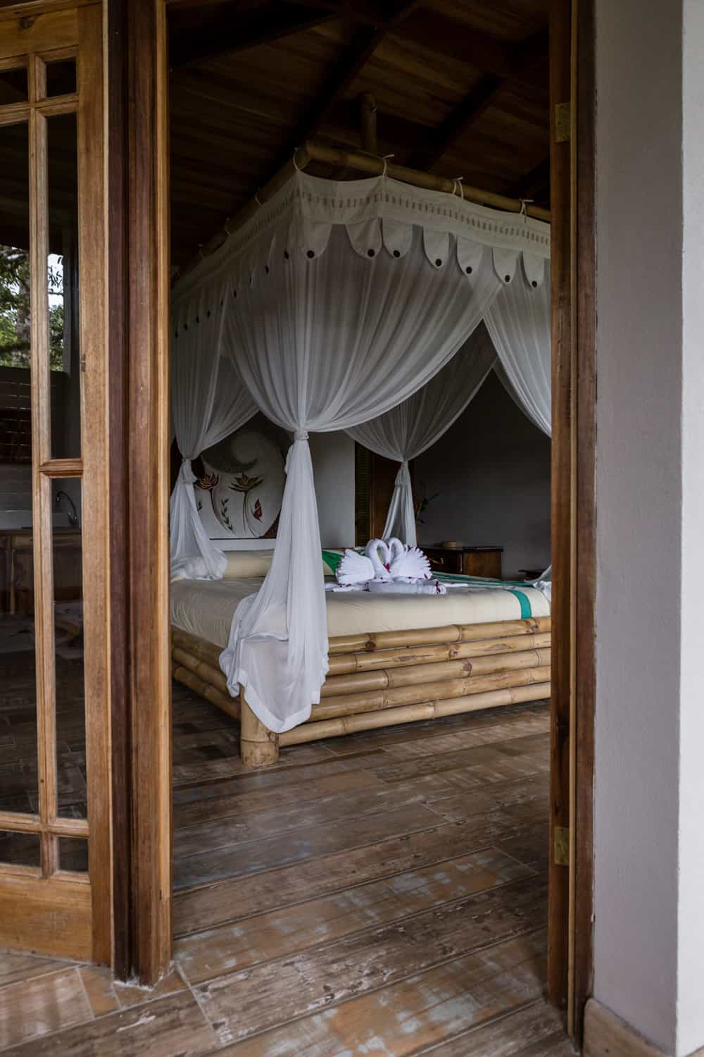 Lost Iguana's beautiful king canopy bed for just married couple.