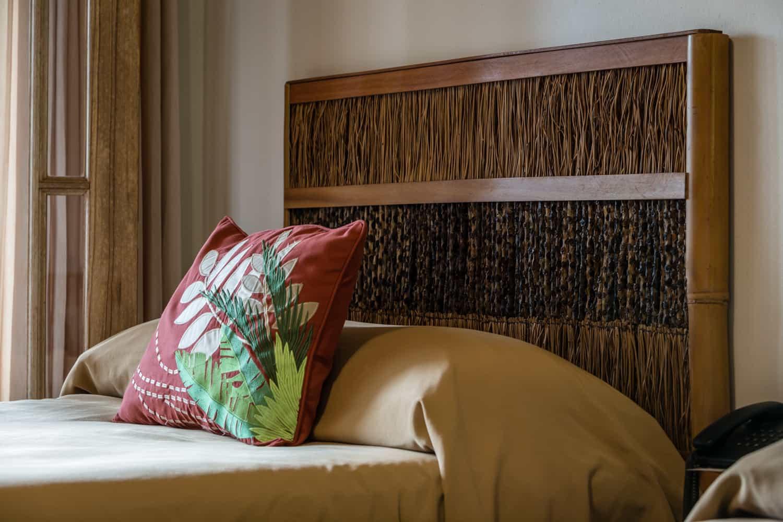 Twin bed headboard in wedding guest room.