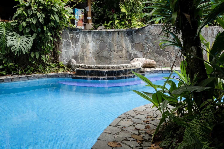 Pool near bar and terrace area for wedding reception.