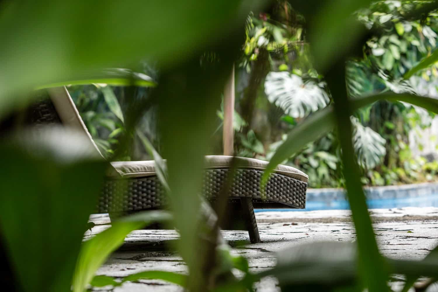 Lounge chair on pool terrace at wedding destination resort in La Fortuna.