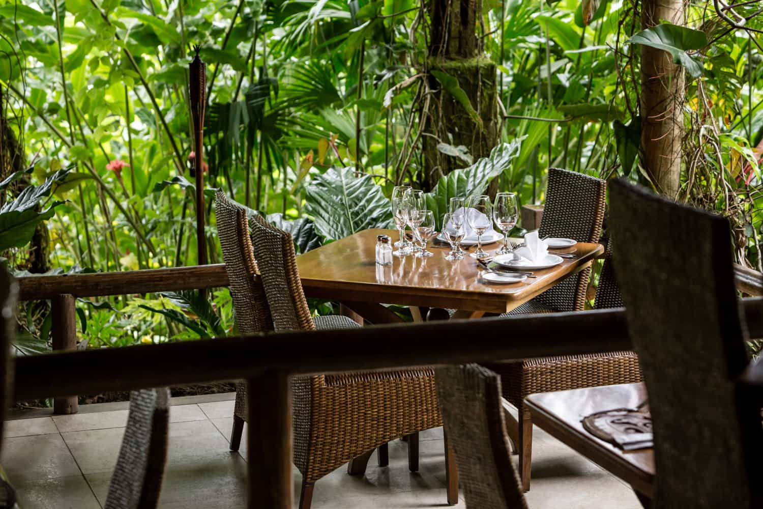 Bride and groom dinner table in La Fortuna restaurant surrounded by rainforest.