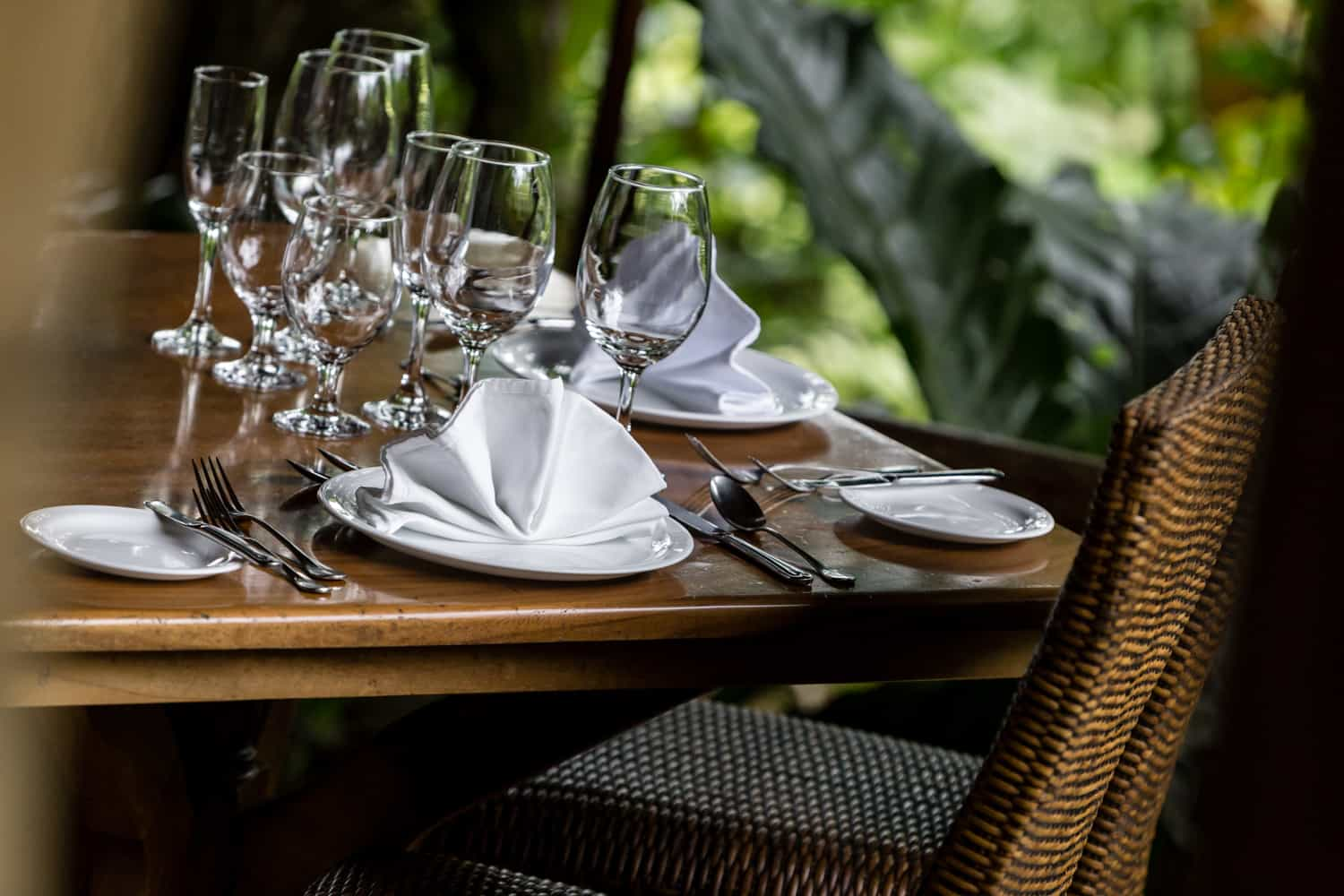 Bride and groom dinner table for intimate reception in rainforest restaurant.