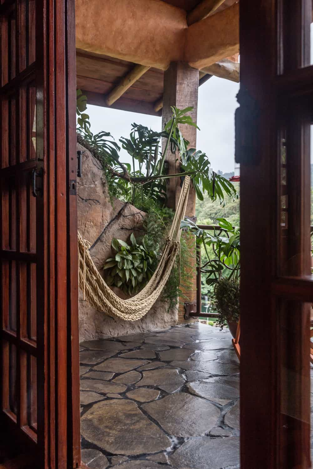 Doorway to balcony with hammock in suite for newlyweds in Costa Rica.