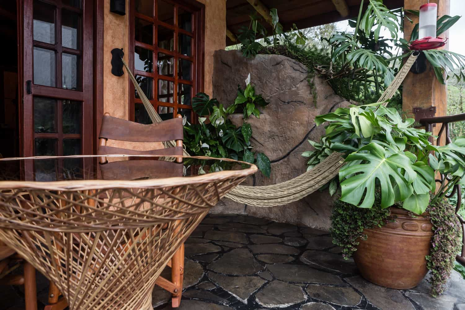 Hammock near balcony entrance in luxury accommodations for just married couple.