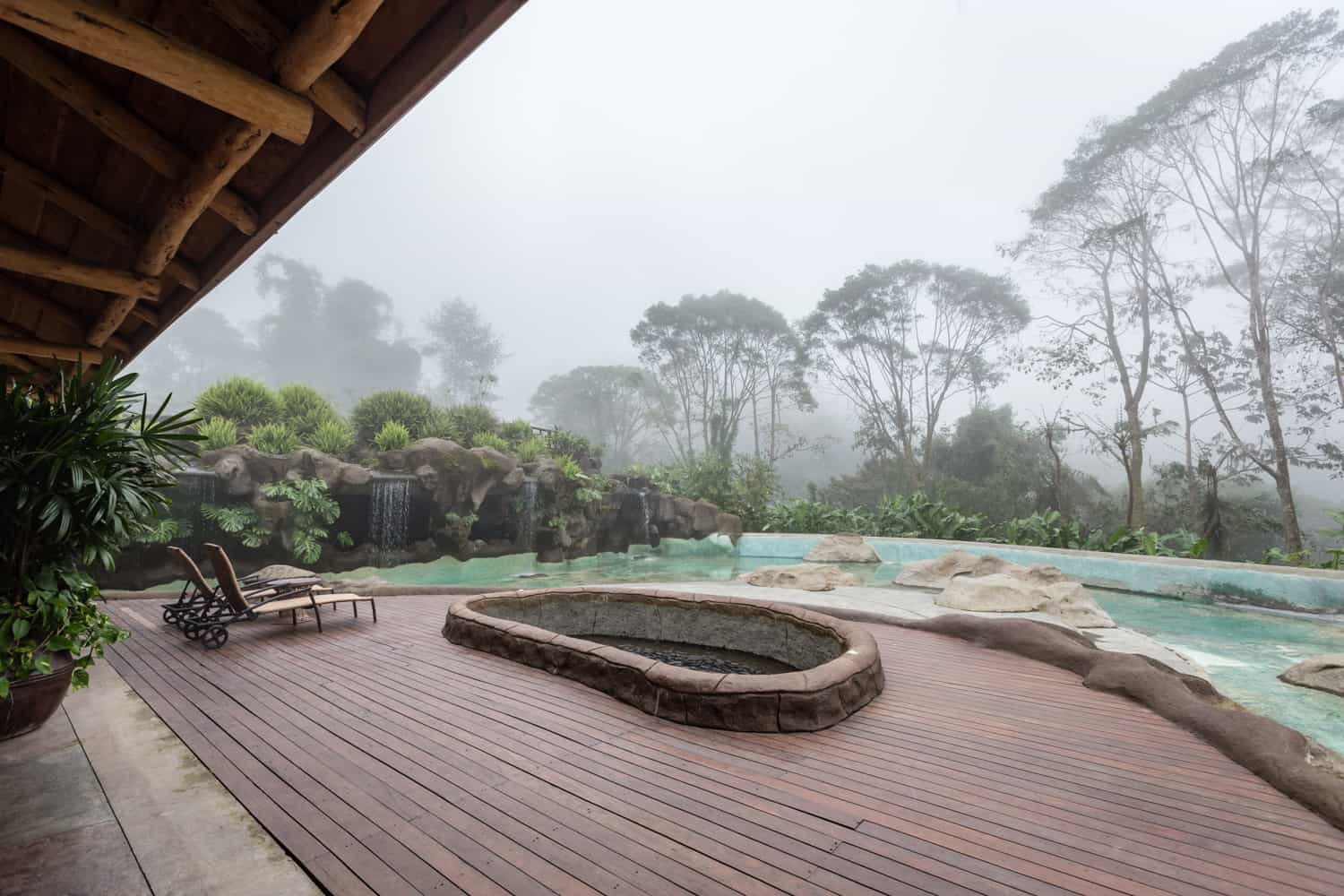 Big Trout Bar pool deck with hot tub with view of cloud forest.