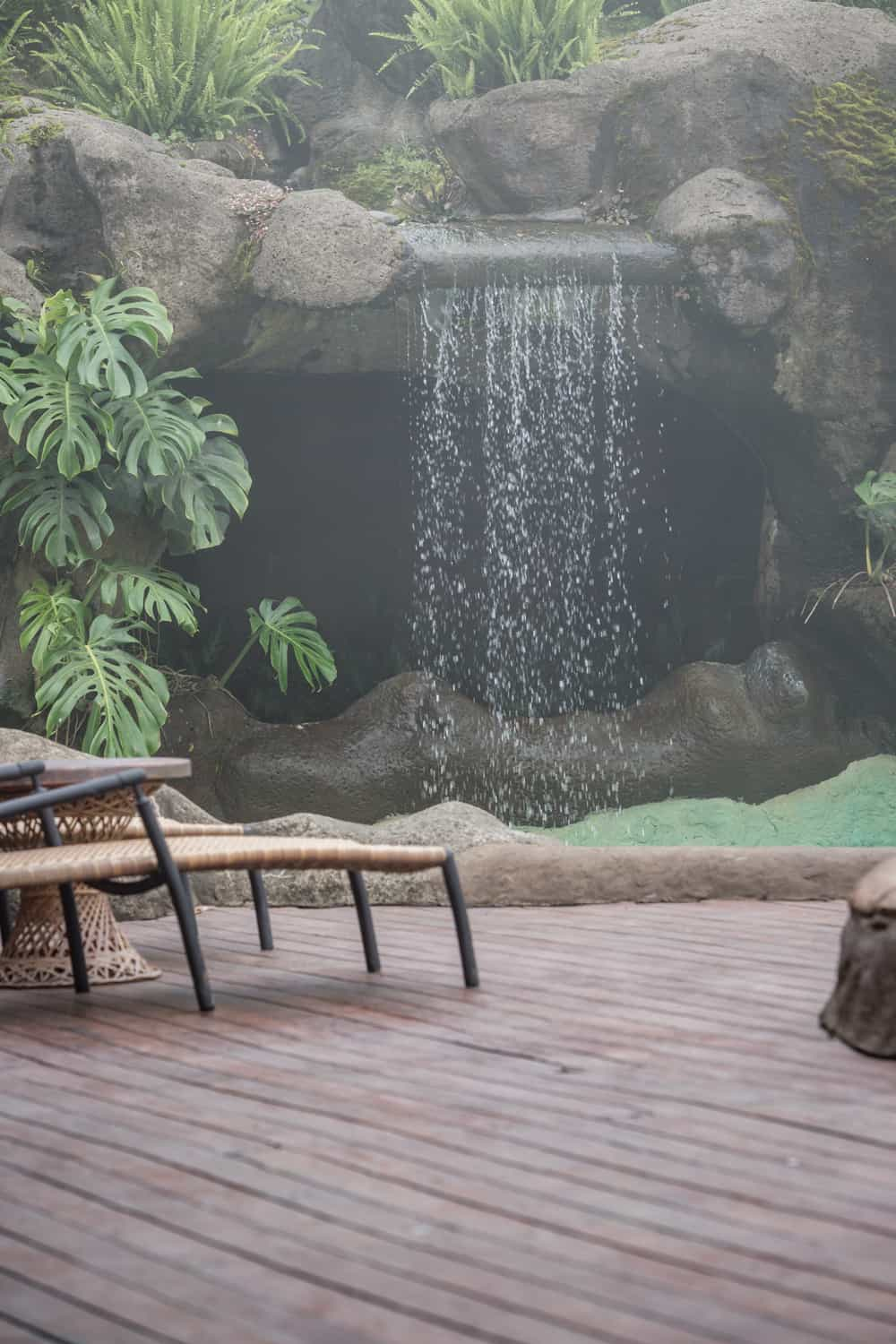 Picture of deck chairs and waterfall at Peace Lodge wedding venue.