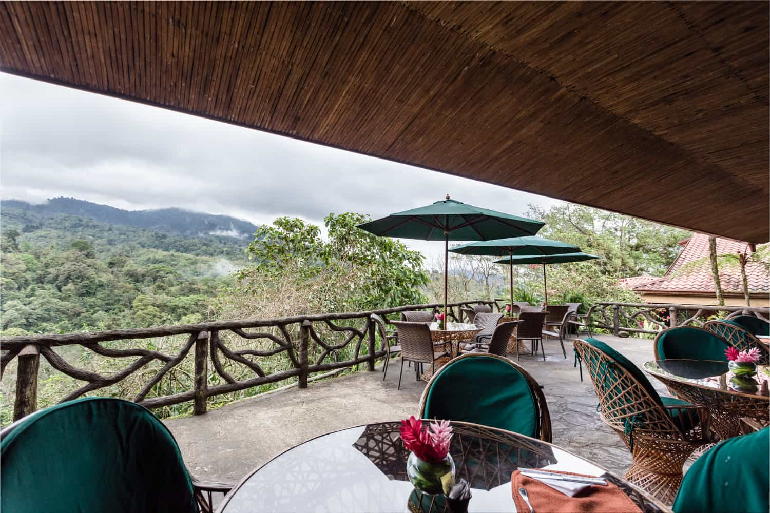 Uncovered terrace overlooking Poas Volcano and cloud forest at La Paz Waterfall Gardens.