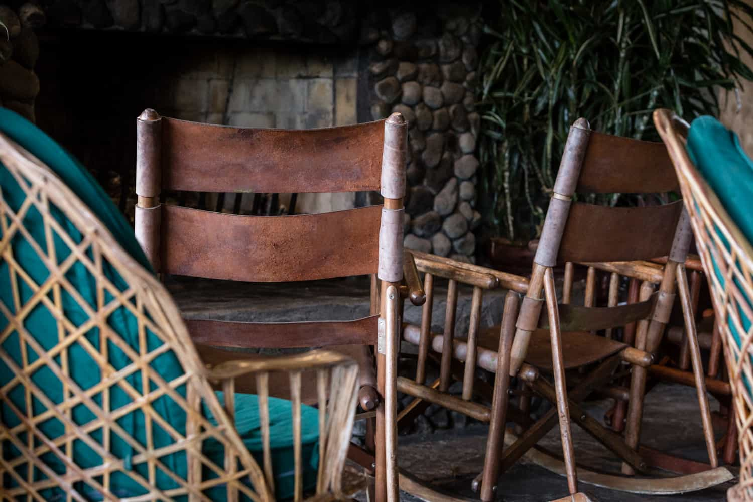 Leather chairs in front of fireplace inside Tortillas Restaurant at La Paz Waterfall Gardens.