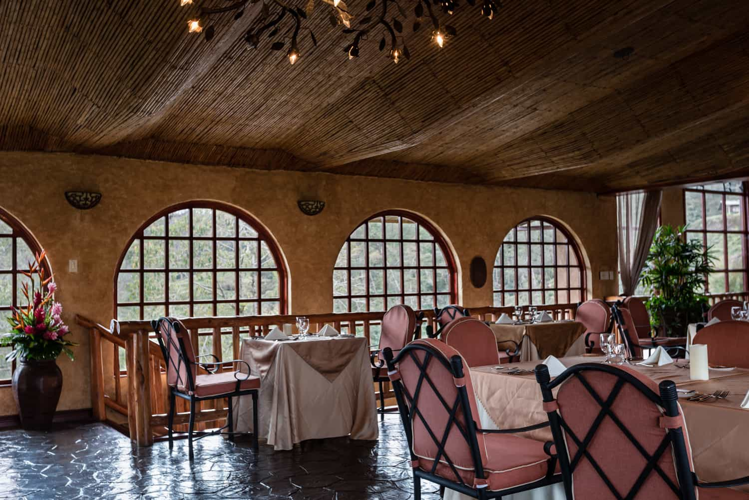 Small and large tables in Vista Poas Restaurant for wedding guests at Peace Lodge.