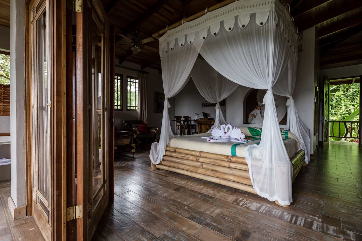 Photo of wood canopy bed in Honeymoon Suite from balcony.