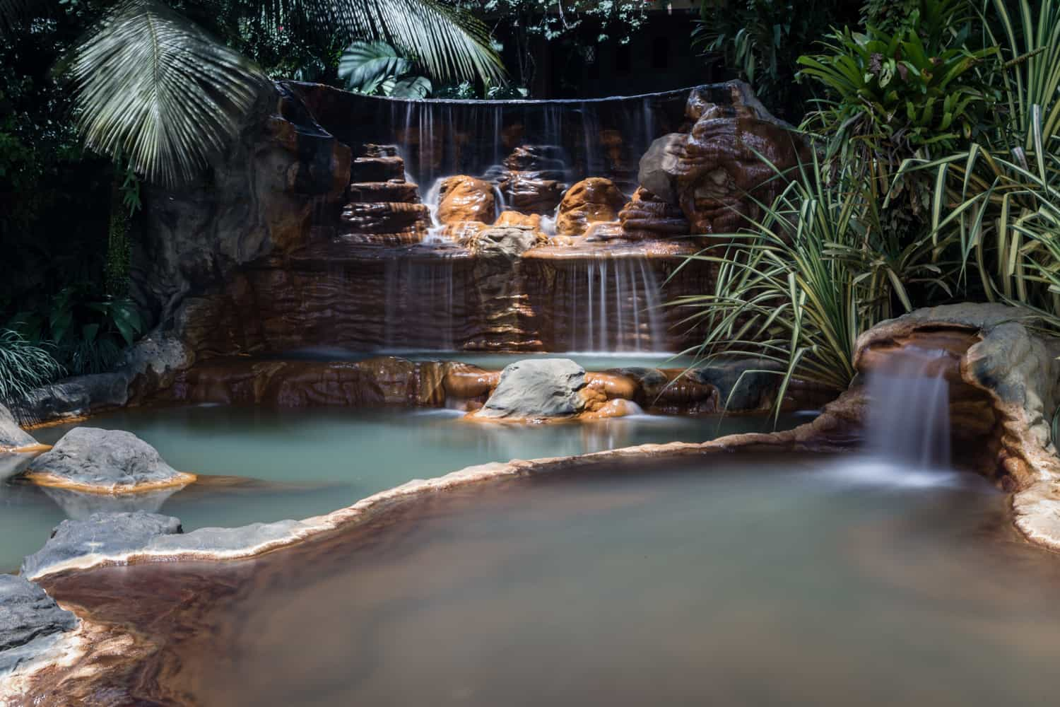 Cascading waterfalls in one of the many thermal pools at The Springs Resort & Spa in Costa Rica.