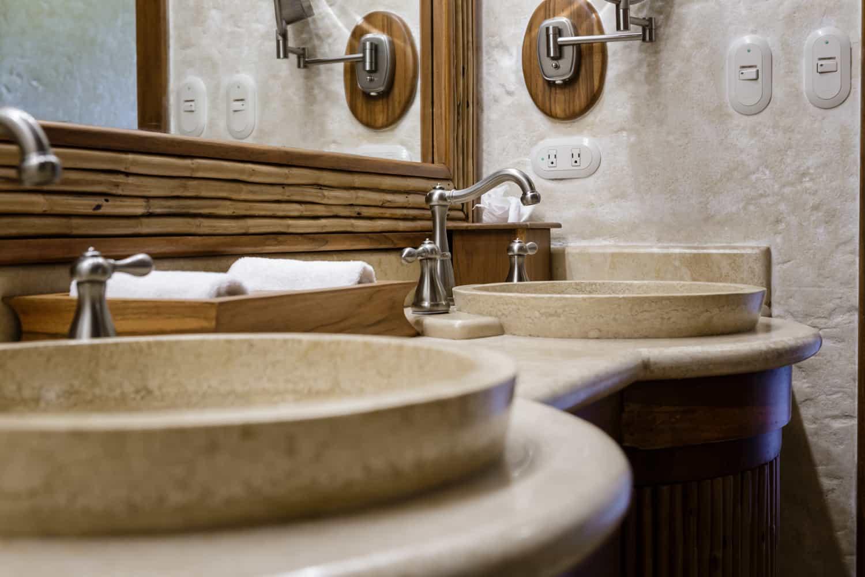 Stone vanity sinks in honeymoon suite bathroom.