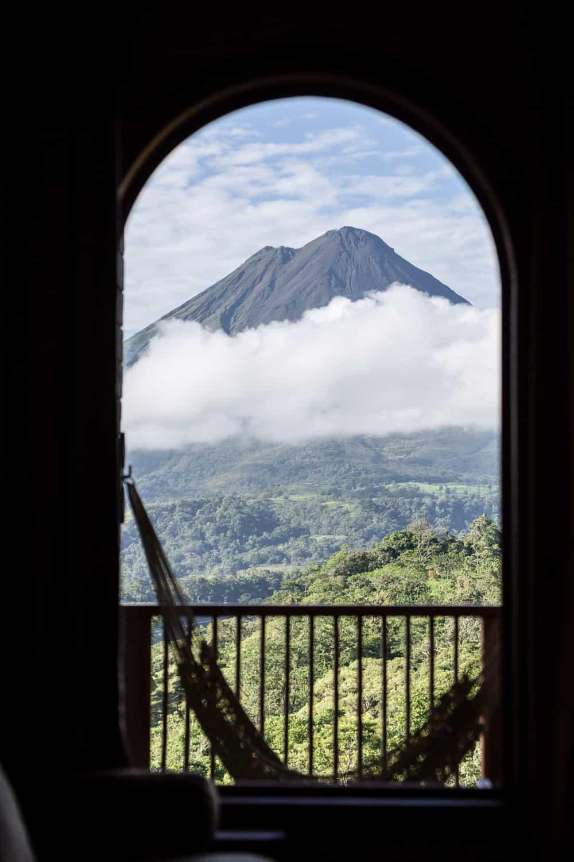 View of Arenal Volcano from vanity chair in honeymoon suite.