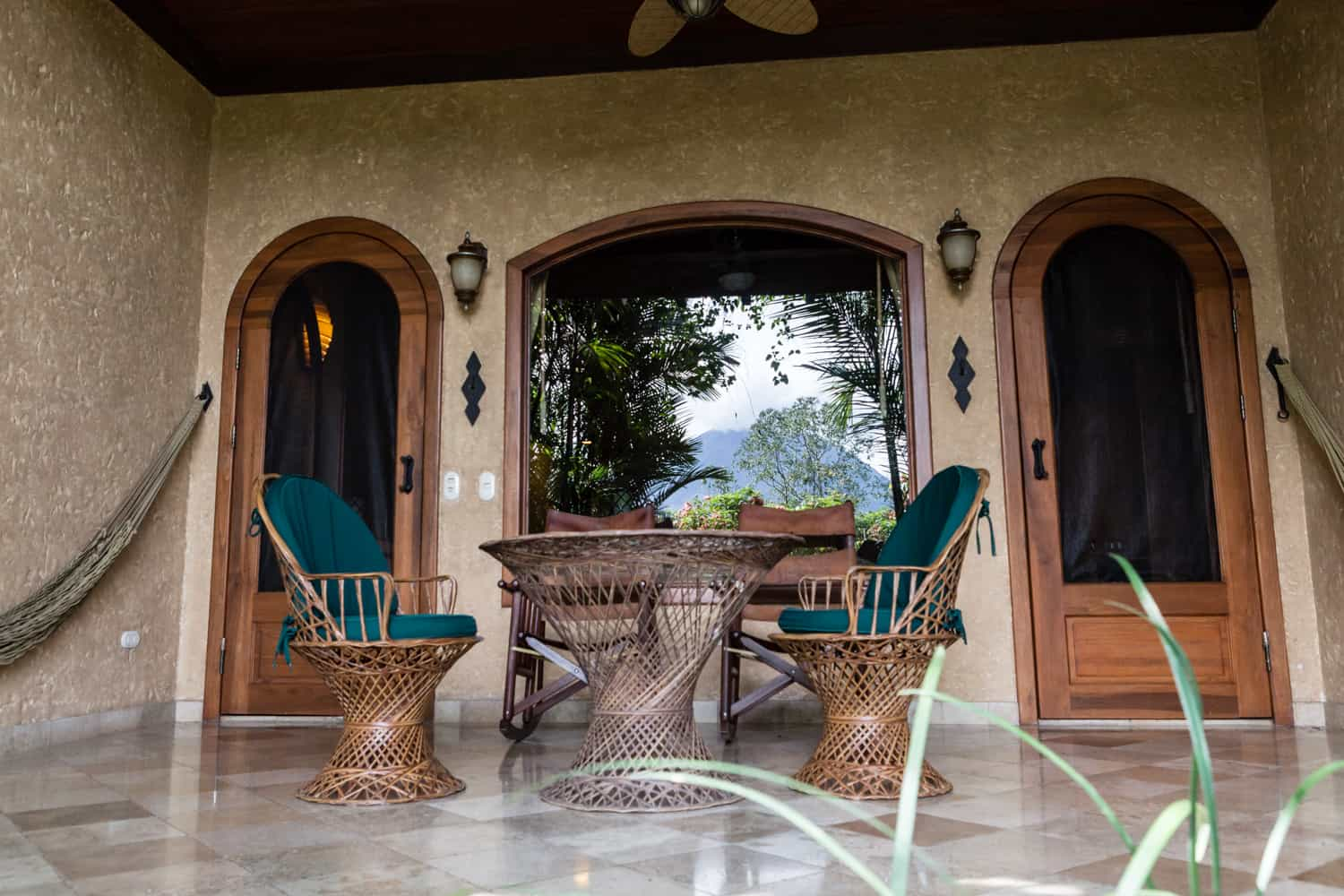 Honeymoon suite patio with hammocks and chairs.