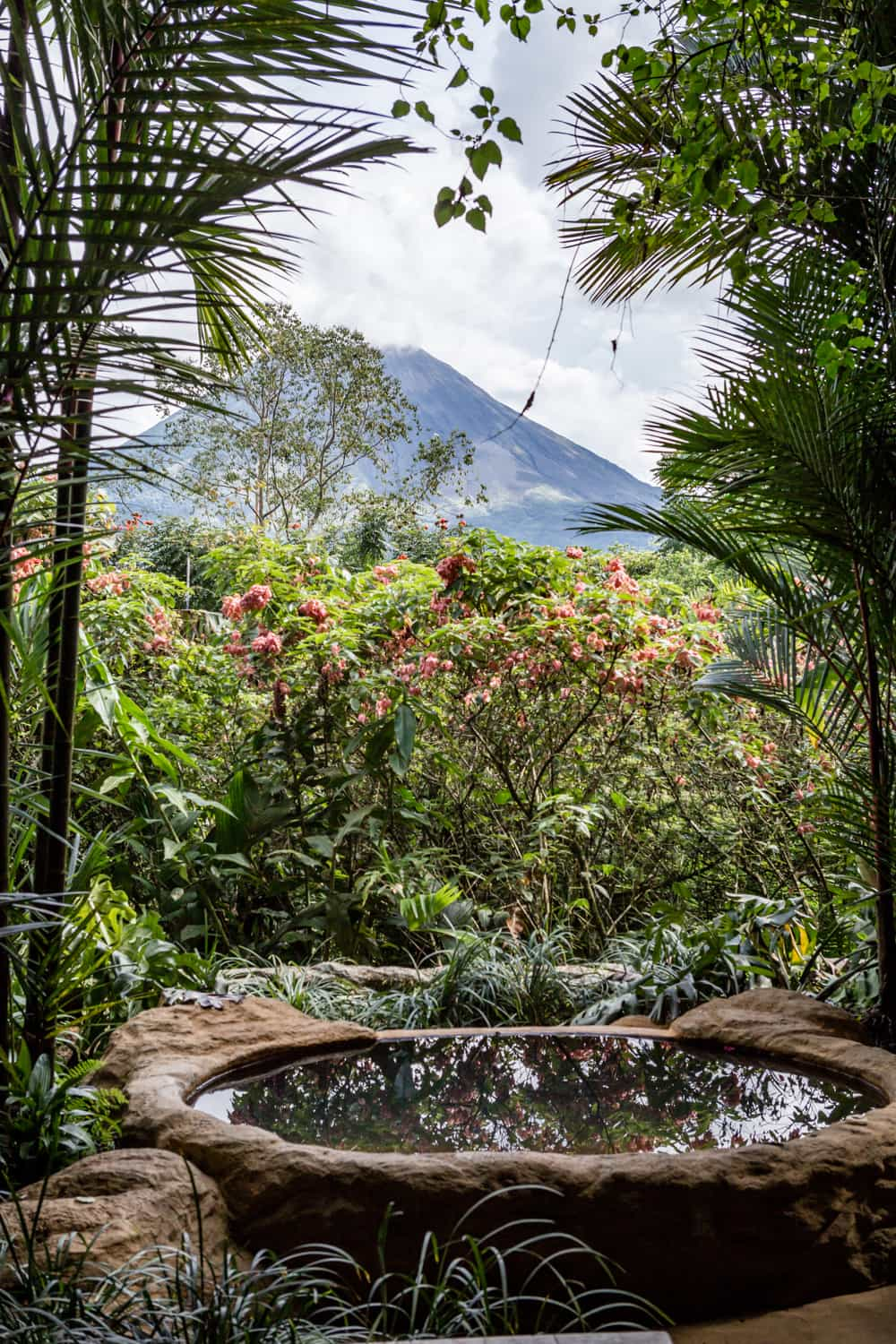 Newlywed suite stone hot tub with view of Arenal Volcano.