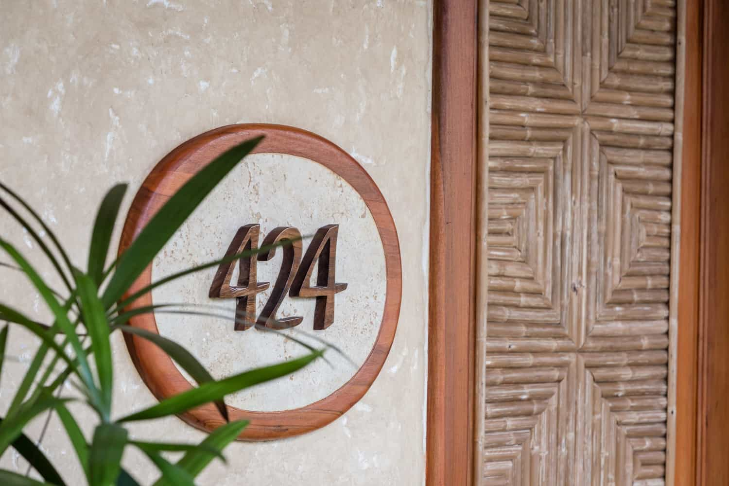 Vista Guest Room unit number with solid wood surrounding.