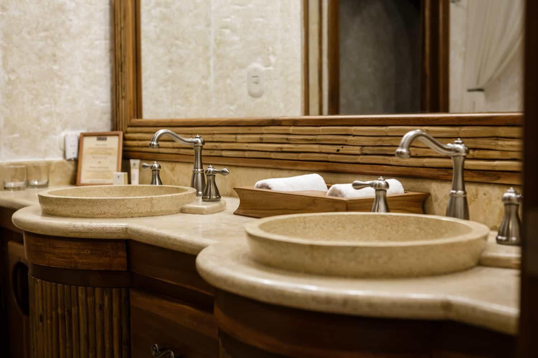 Dual stone sink vanity in large guest room bathroom at Springs Resort.