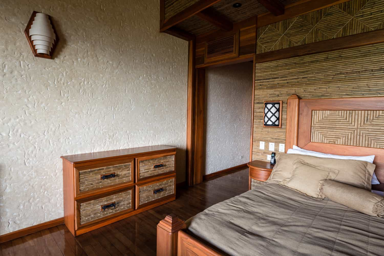 Dresser on wood floor near Springs Resort guest room entrance.