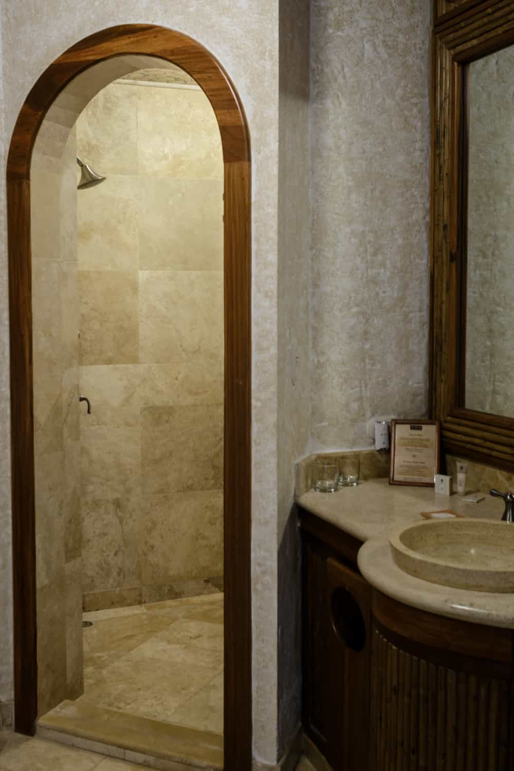 Stone walk-in shower in Spings Resort deluxe accommodations.