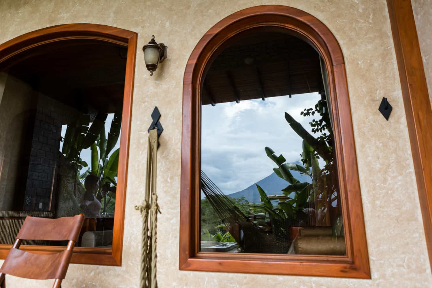 Reflection of Arenal Volcano in balcony windows.