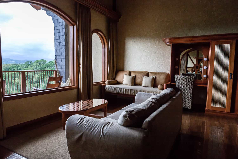 Couch in main bedroom facing window.