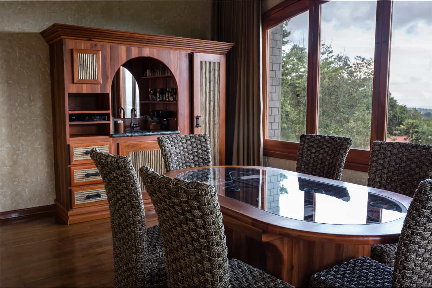 Dining table for wedding guests who can enjoy views of rainforest.