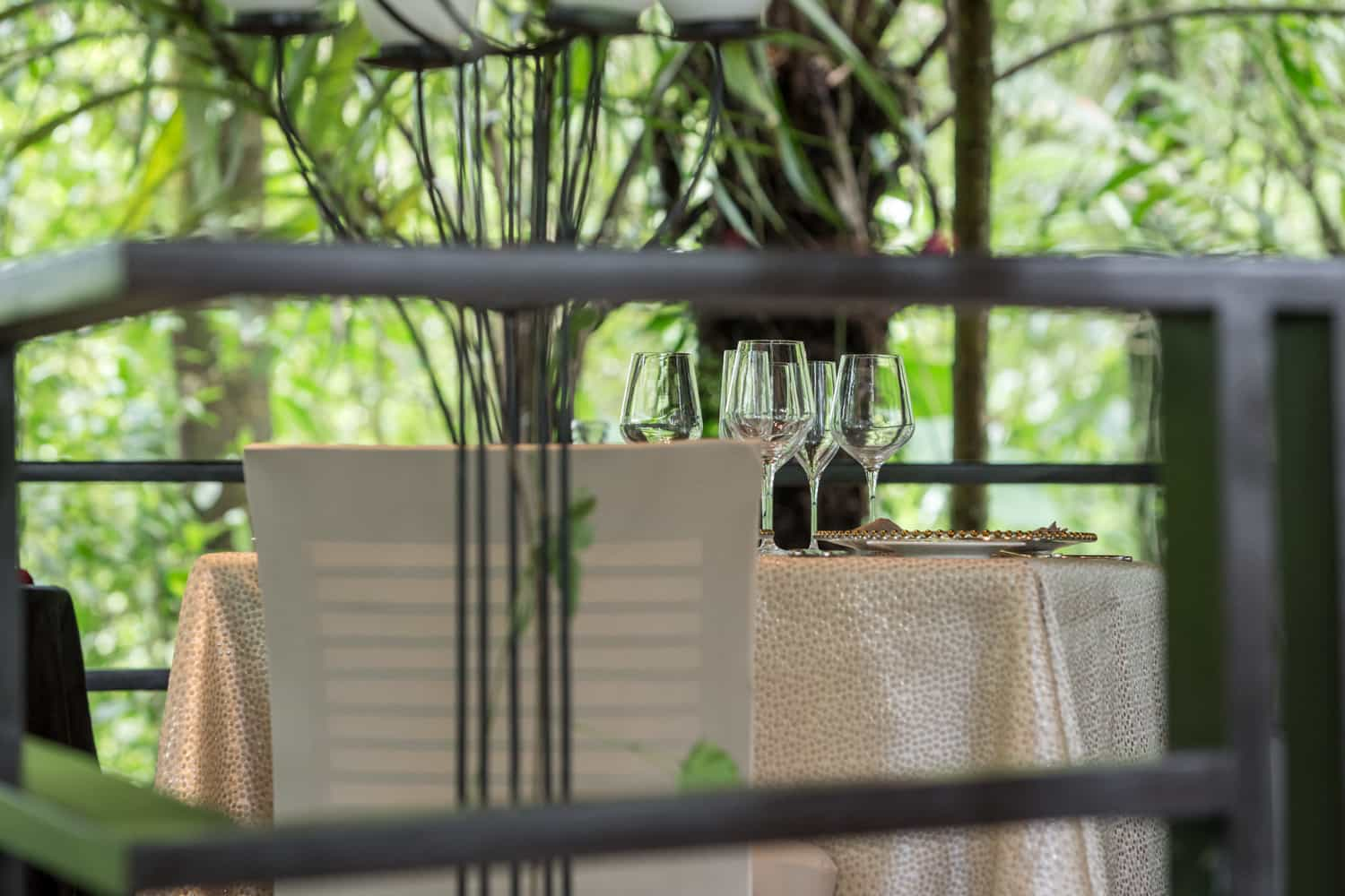 View of dining table for two in intimate jungle setting at Tabacon.