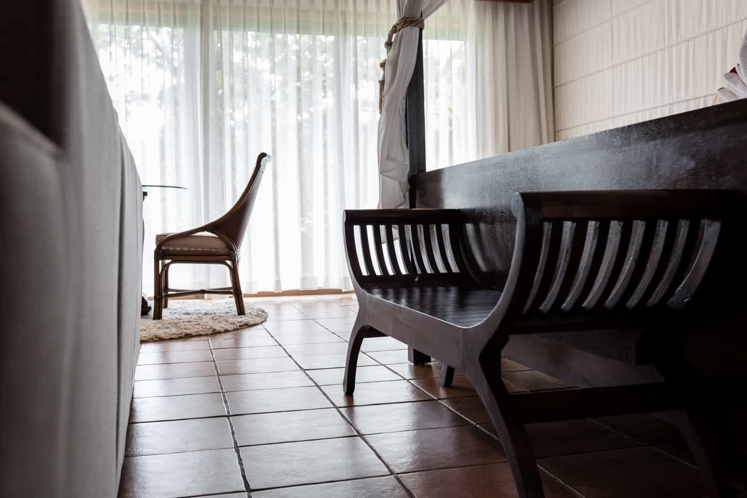 Solid wood bed bench in suite for newlyweds.