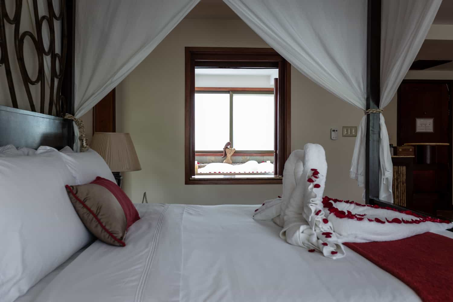 View of honeymoon suite bathroom from canopy bed.