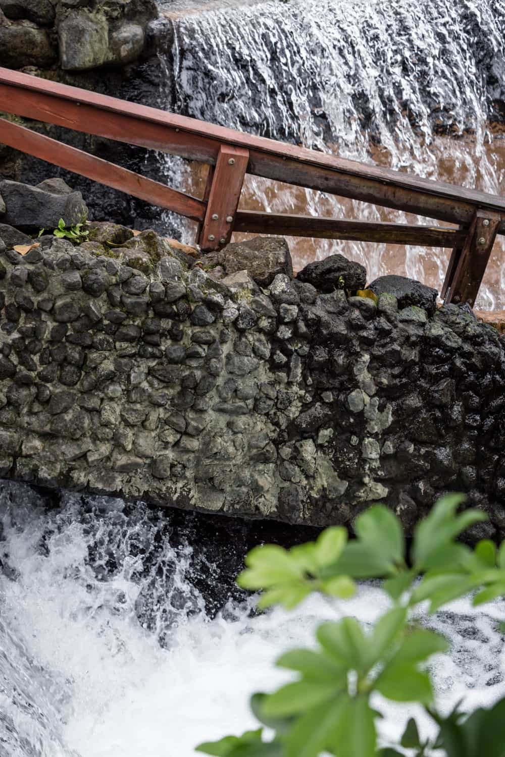 Stone wall separates to streams fed by thermal springs.