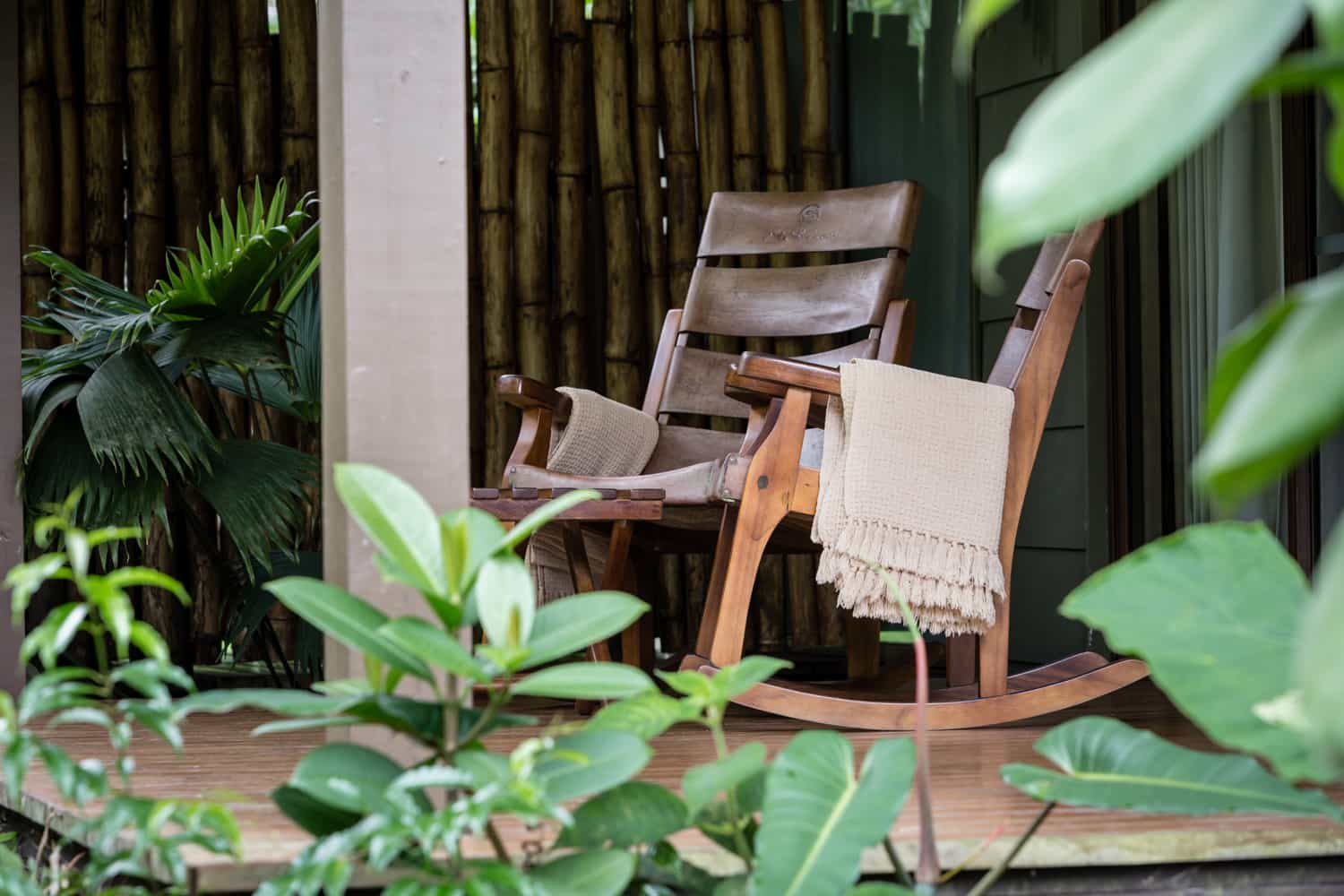 Wood & leather rocking chairs on guest room porch.
