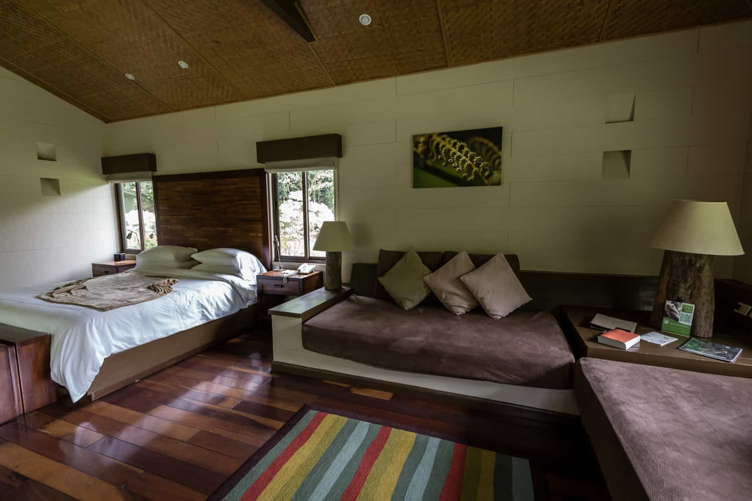 Bedroom and seating area in honeymoon suite with wood floors.