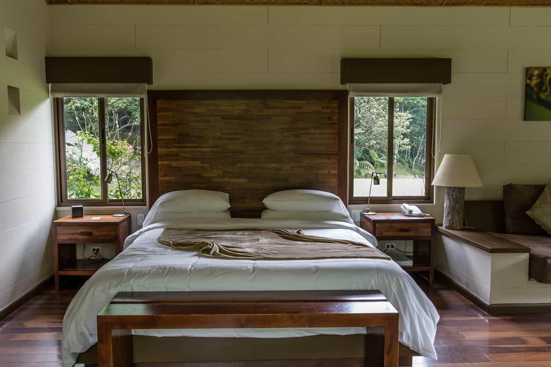 Beautiful wood bed in room used as a honeymoon suite at El Silencio.